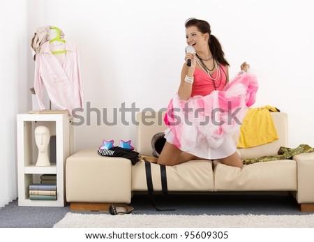 Pretty teenage girl having fun at home, singing, posing, laughing.? - stock photo