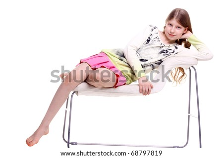 pretty teenage girl relaxing isolated on white - stock photo