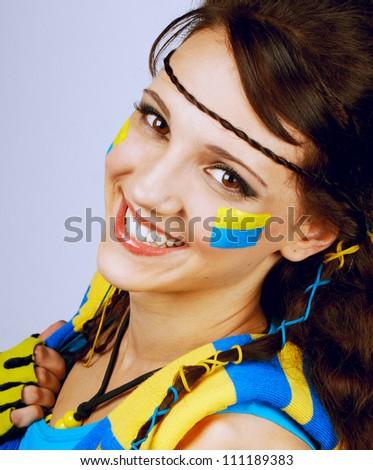 Pretty teenage soccer football fan - stock photo