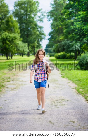 Pretty teenager girl in casual clothes going to school on sunny september day, outdoor portrait - stock photo
