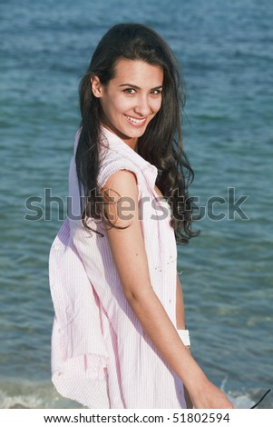 Pretty Teenager Posing on the Beach - stock photo