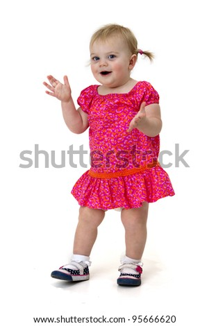 pretty toddler girl clapping her hands - stock photo