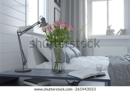 Pretty vase of fresh pink roses in a modern bedroom interior standing alongside an anglepoise lamp on the bedside table. 3d Rendering - stock photo