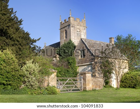 Pretty village church and cottage, England - stock photo
