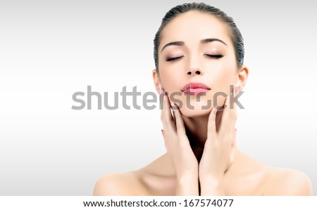 Pretty woman against a grey background  - stock photo