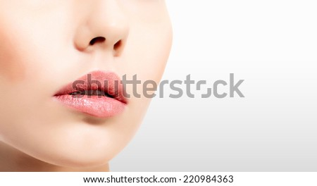 Pretty woman against a grey steel background with copyspace - stock photo