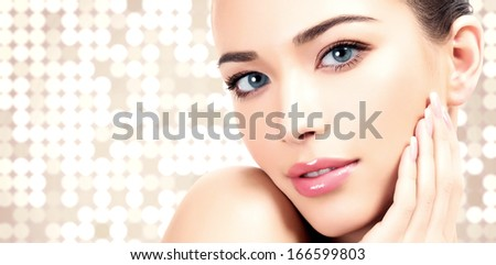 Pretty woman against an abstract background with circles and copyspace.  - stock photo
