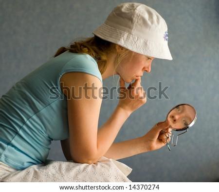 pretty woman and mirror - stock photo