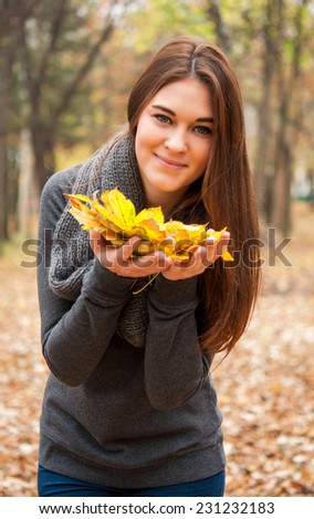 Pretty woman at the autumn park  - stock photo