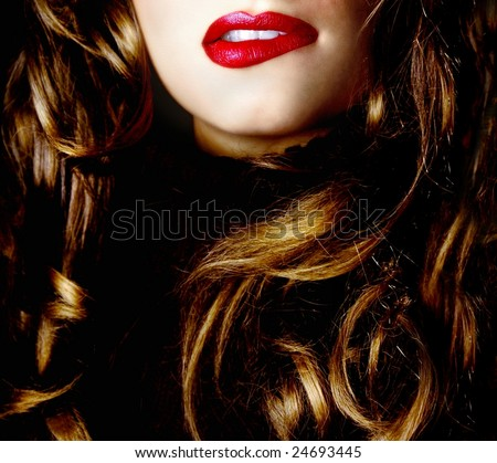 Pretty woman biting her lips - stock photo