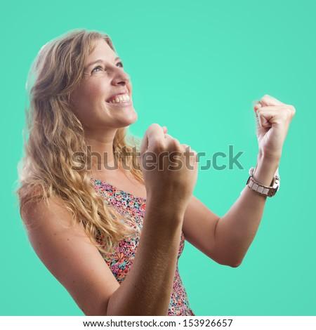 pretty woman celebrating her success - stock photo