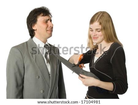 Pretty woman cutting man's necktie with scissors - stock photo