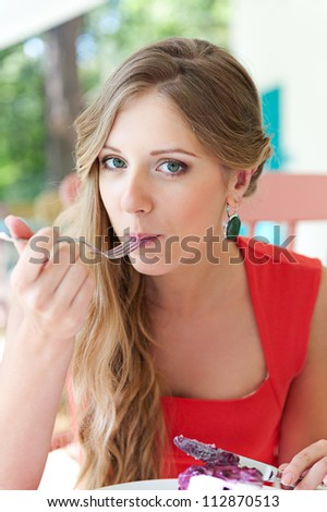pretty woman eating delicious dessert - stock photo