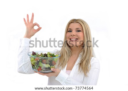 Pretty woman eating green vegetable salad. isolated on white - stock photo