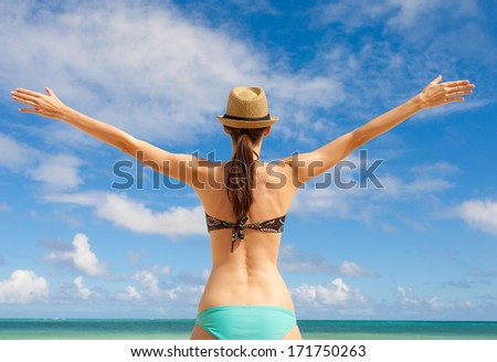 Pretty woman enjoying summer beach.Freedom concept. Enjoyment. - stock photo