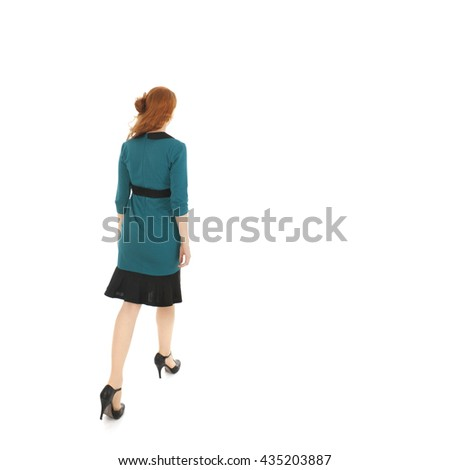 pretty woman formal dressed walking away in studio isolated over white background - stock photo