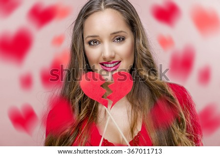 Pretty woman holdig broken heart in Valentines Day. - stock photo