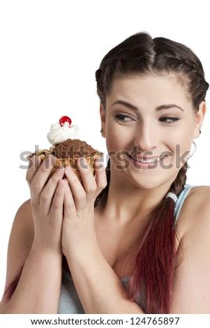 Pretty woman holding a cone of chocolate ice cream - stock photo
