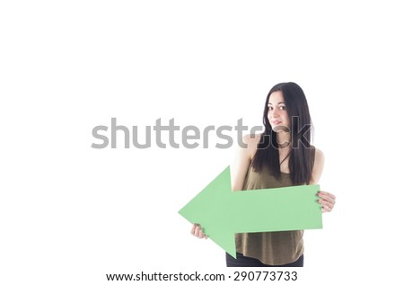 Pretty woman holding an arrow sign against a white background - stock photo