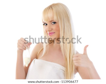 Pretty woman holding condom and giving thumbs up on white background - stock photo