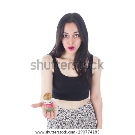 Pretty woman holding different color macaroon on with her hand against a white background - stock photo