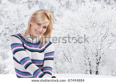 pretty woman in a beauty fashion shot wearing a colored warm and comfortable sweater against white background - stock photo