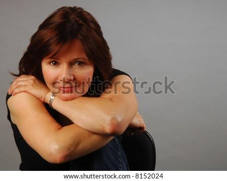 Pretty woman in a contemplative but happy mood - stock photo