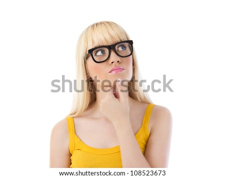 Pretty woman in glasses looking up and thinking over white - stock photo