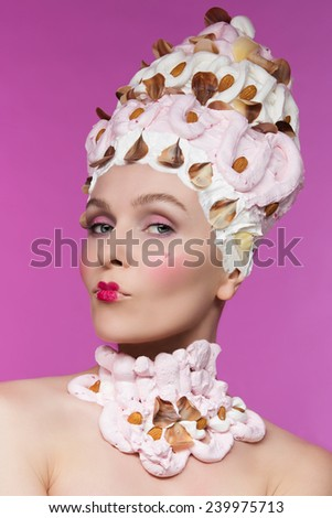 Pretty woman in headdress decorated with meringues and nuts - stock photo