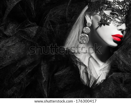 pretty woman in mask looking at camera . - stock photo
