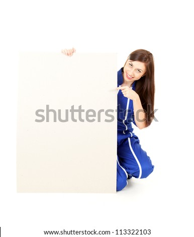 pretty woman in overalls showing blank sign, white background. - stock photo