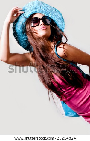 pretty woman in pink summer dress, hat and sunglasses - stock photo