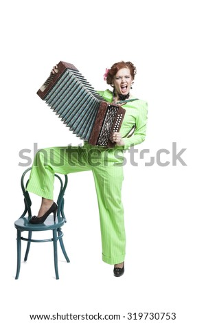 Pretty woman in Retro style costume playing accordion - stock photo