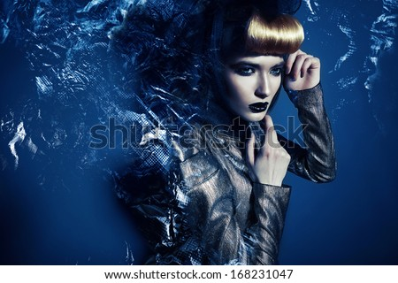 pretty woman in silver blazer and abstract - stock photo