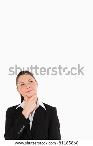Pretty woman in suit posing while standing against a white background - stock photo