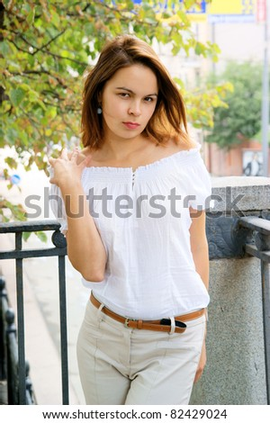 Pretty woman in summer dress in big city - stock photo