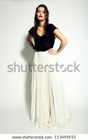 pretty woman in white skirt - stock photo