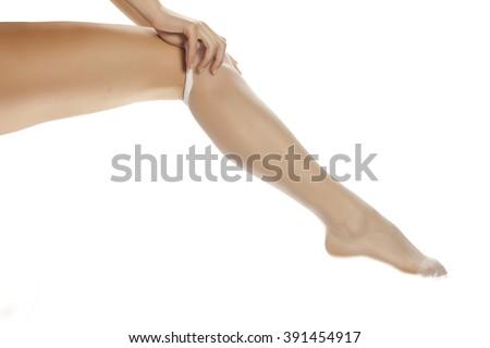 pretty woman leg in white stockings - stock photo