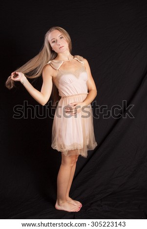Pretty woman looking happy with a smile - stock photo
