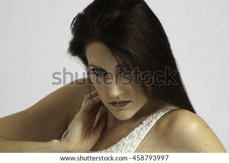 Pretty woman looking thoughtfully at the camera - stock photo