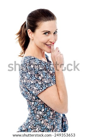 Pretty woman making silence gesture - stock photo