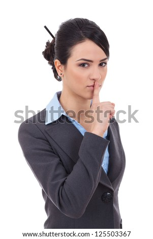 pretty woman making silence sign over grey background - stock photo