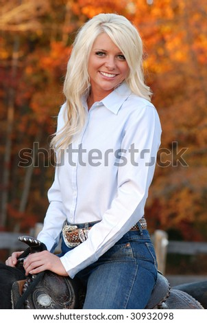 Pretty Woman on Horse - stock photo