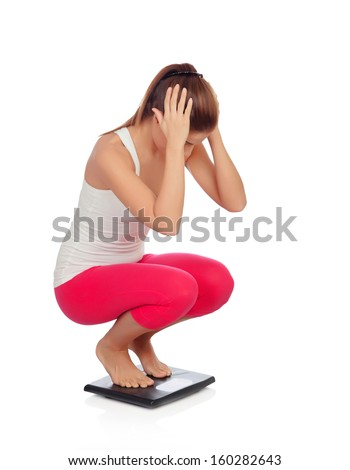 Pretty woman on seeing his new weight scale isolated on a white background - stock photo