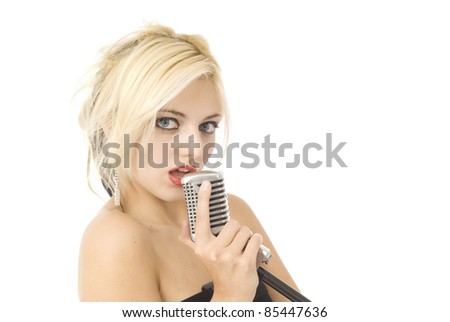 Pretty woman or girl music singer with microphone isolated on white - stock photo
