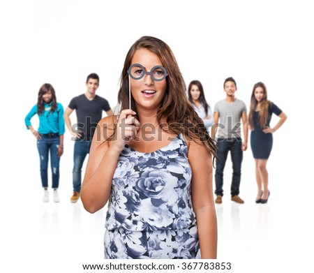 pretty woman playing with party accessories - stock photo