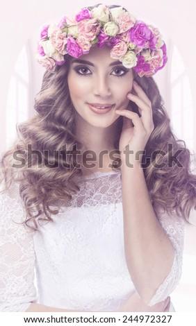 Pretty woman portrait with flowers tiara - stock photo