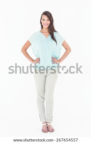 Pretty woman posing smiling at camera on white background - stock photo