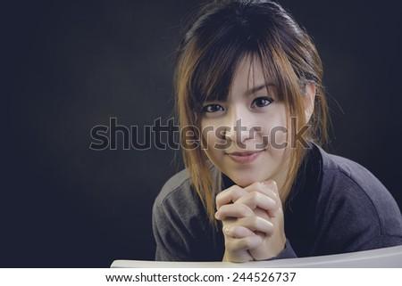 Pretty woman Profile portrait of the fashion model posing at studio - stock photo