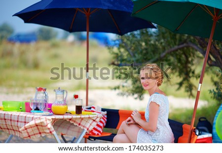 pretty woman relaxing on summer picnic - stock photo